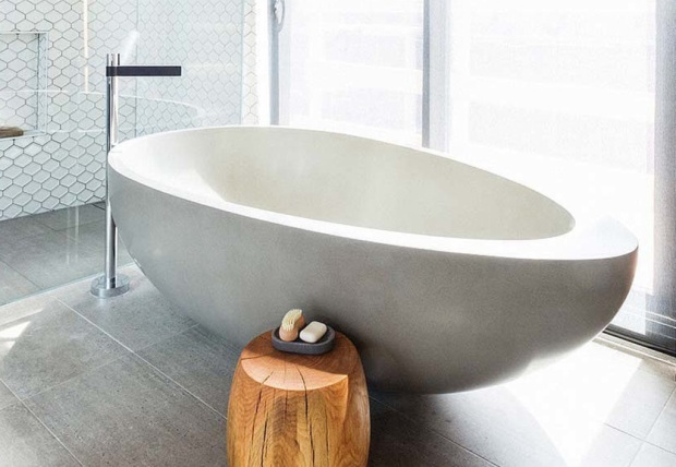 Egg shaped stone bath via The Block